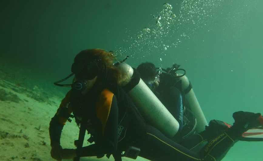 Divers on lake bottom