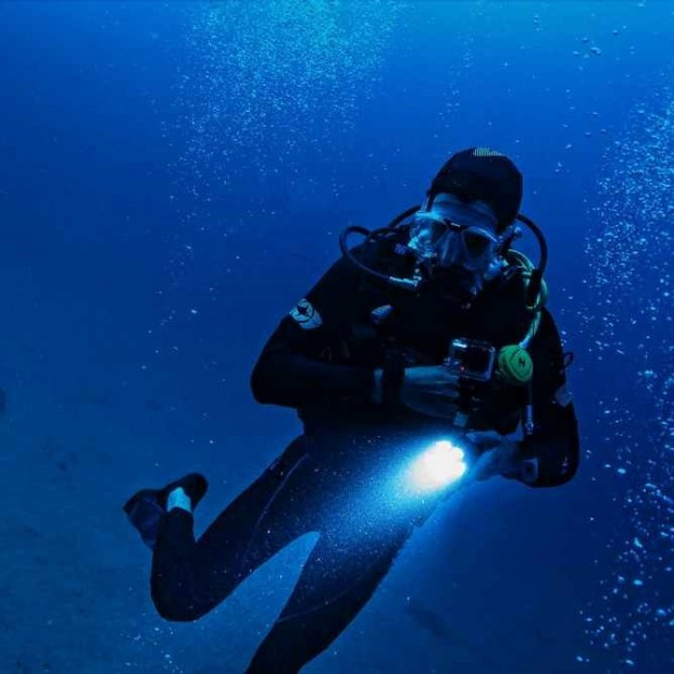 Diver with flashlight