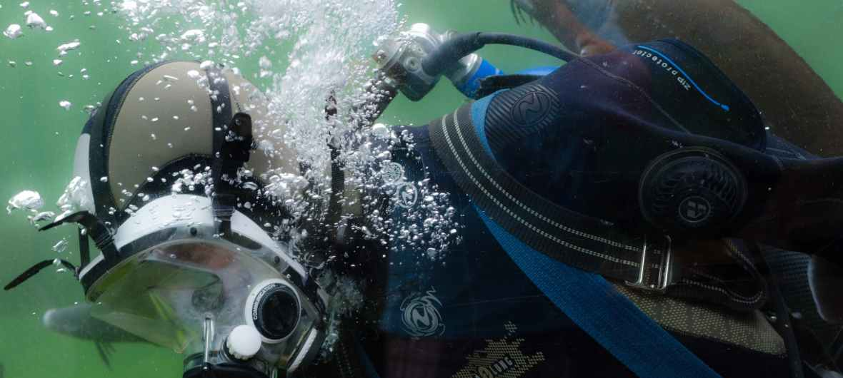 Diver, bubbles and large mask