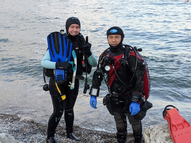 New scuba diver and NAUI instructor on checkout certification dive