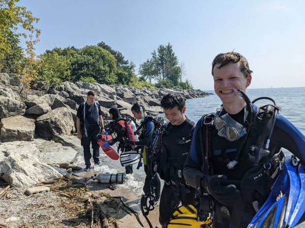 Lake Ontario shore dive with divers exiting the water